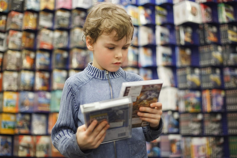 Boy holding DVD and Blu-Ray