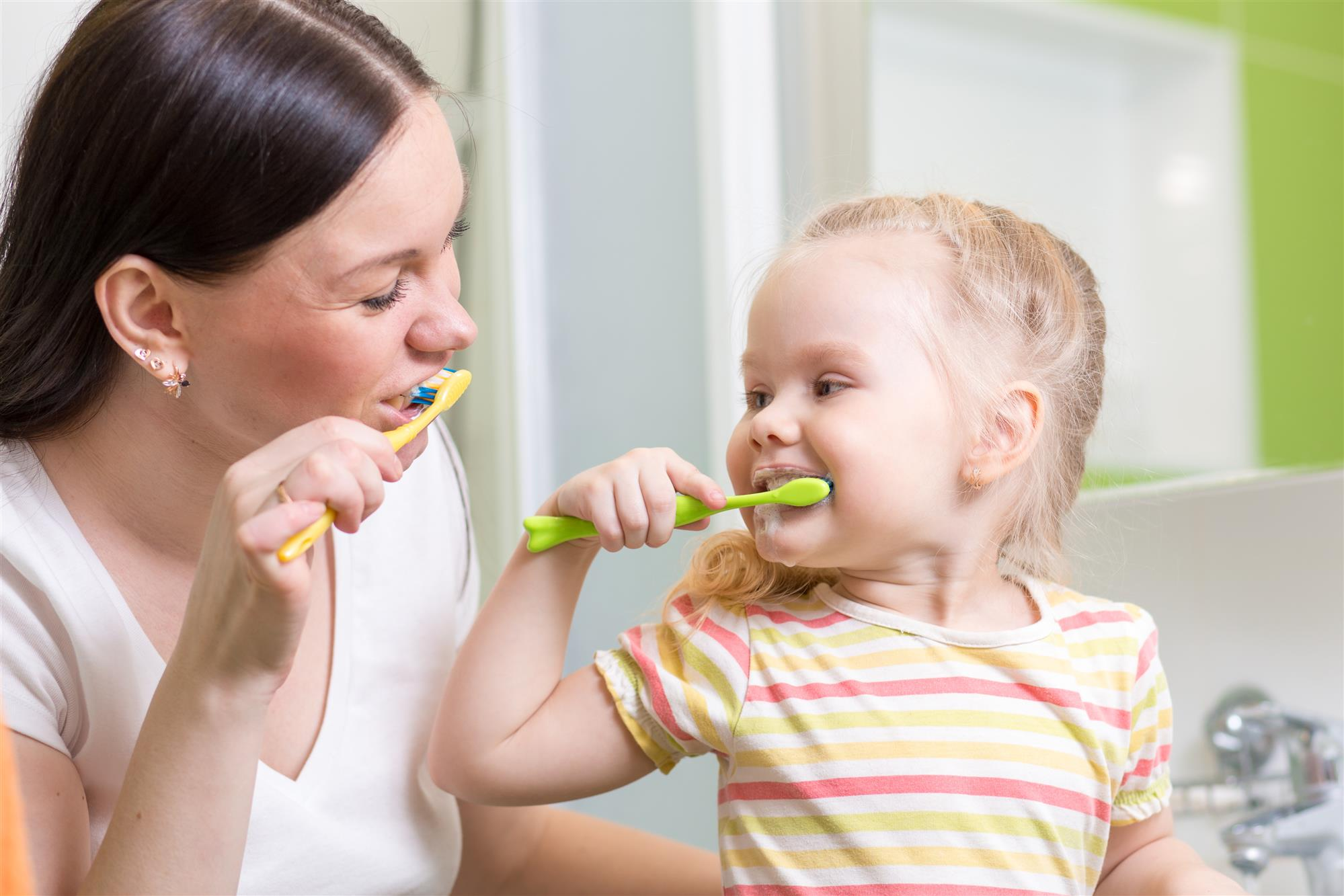 Mom Brushing Teeth with Girl